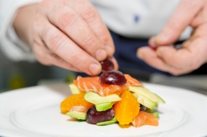 Chef is decorating delicious dish